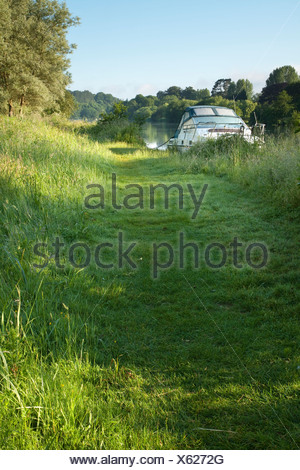 Pleasure boat moored on the Thames at Child Beale near Pangbourne Berkshire Uk - Stock Photo