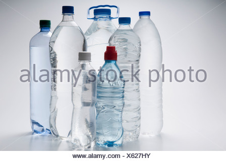Assorted bottles of water - Stock Photo