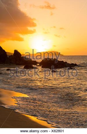 Sunset off coast of St Thomas - Stock Photo