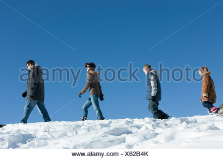 USA, Utah, Big Cottonwood Canyon, family walking in snow - Stock Photo