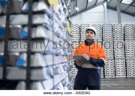 Warehouse worker checking stock - Stock Photo