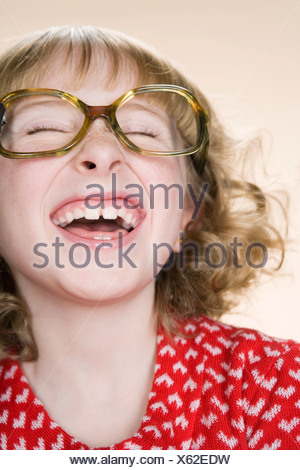 A geeky girl laughing - Stock Photo