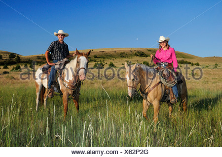 Pacific Northwest, Oregon, USA, United States, America, riding, horseback, sport, horse, ranch, cowboy, cowgirl, girl, woman, gr - Stock Photo