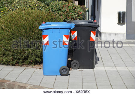colored garbage bins to help separate and recycle. - Stock Photo
