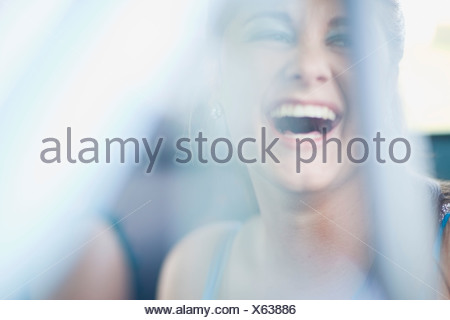 Teenage girl laughing - Stock Photo