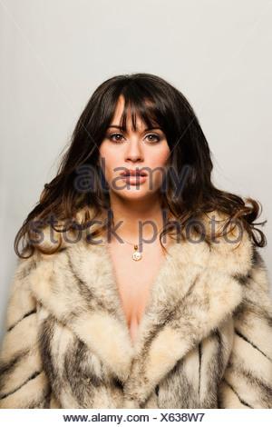 A woman in a fur coat.