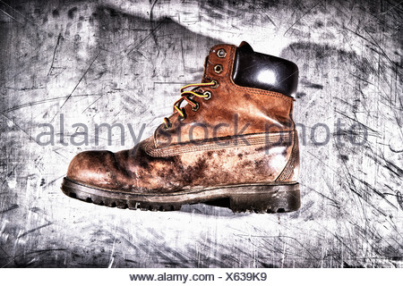 Dirty hiking boot - Stock Photo