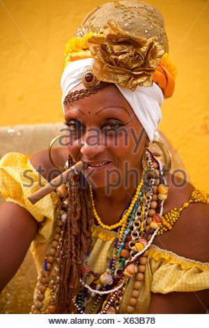 Senora Habana, a priestess of the Afro-Cuban Santeria or Santera, with a cigar, Havana, Cuba - Stock Photo
