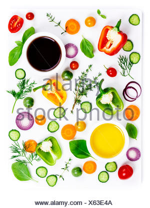 Composition of Fresh organic vegetables (pepper, onion, cucumber, carrot, tomatoe), herbs, olive oil and vinegar  isolated on white background, top vi - Stock Photo