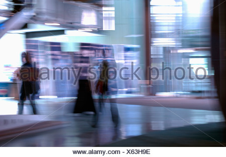 stylised view of people walking with motion blur - Stock Photo