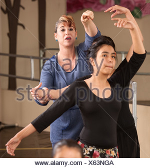 Ballet instructor directs students during dance practice - Stock Photo