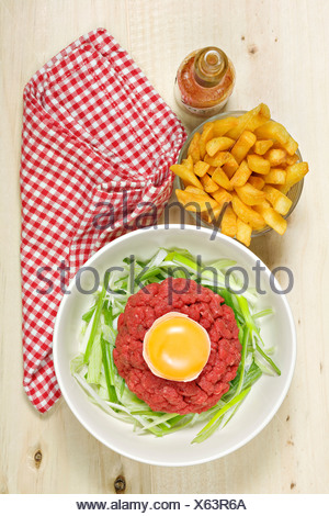Steak tartare with french fries - Stock Photo
