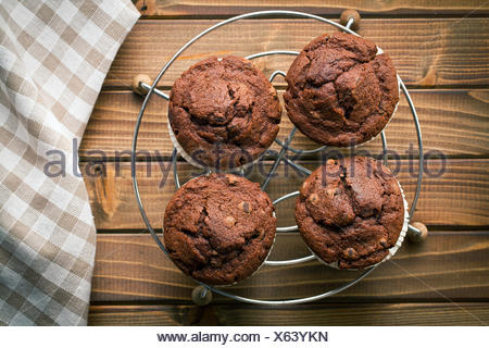 top view of chocolate muffins on wooden table - Stock Photo