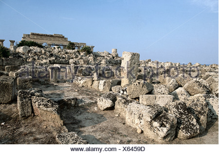 Italy, Sicily, Selinunte, Acropolis, ruins with upper section of Temple C in background - Stock Photo