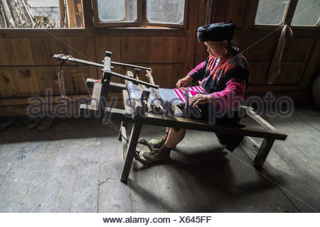 Chinese woman weaving fabric, Guilin, China - Stock Photo