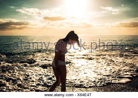 Woman wading in sea - Stock Photo