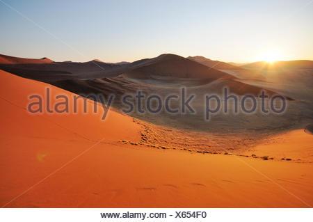 Sunrise view from Dune 45 on a desert landscape with dunes, Tsauchab-Tal, Sossusvlei, Namib-Naukluft-Park, Namib-Wüste, Namibia - Stock Photo