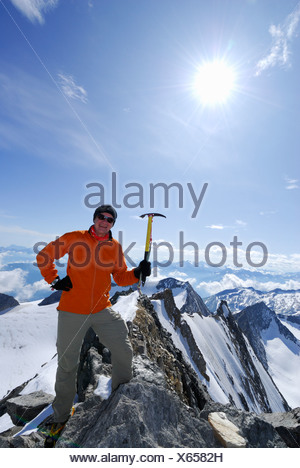 Mountaineer at Hochfeiler summit, Zillertal Alps, South Tyrol, Alto Adige, Italy - Stock Photo