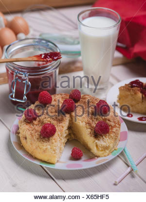 Rustic style of raspberries pie on wooden planks. Debica, Poland - Stock Photo