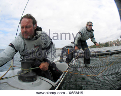 Extreme 40 catamaran demonstration in the Sydney Harbour. - Stock Photo