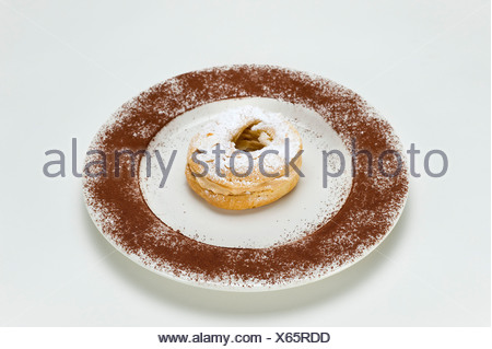 French pastries 'Paris-Brest' named after the cycling race, choux pastry with different fillings, originally with butter cream - Stock Photo