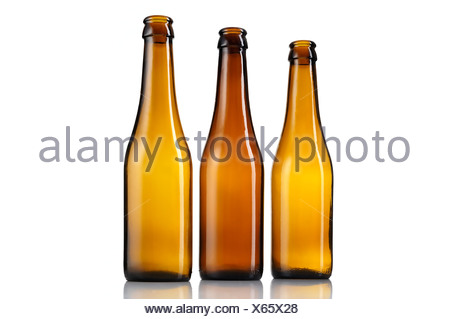 Three empty bottles of beer isolated - Stock Photo