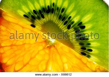Sliced kiwi and mandarin - Stock Photo