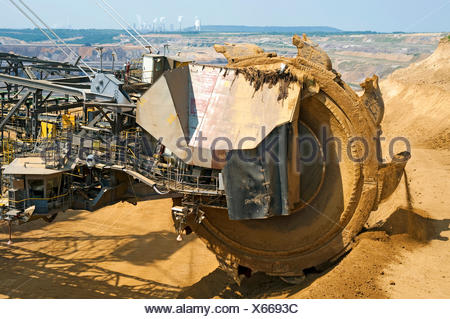 View over the bucket wheel of an excavator onto a coal power plant, Grevenbroich, North Rhine-Westphalia, Germany - Stock Photo