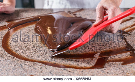 Tempering of the chocolate - Stock Photo