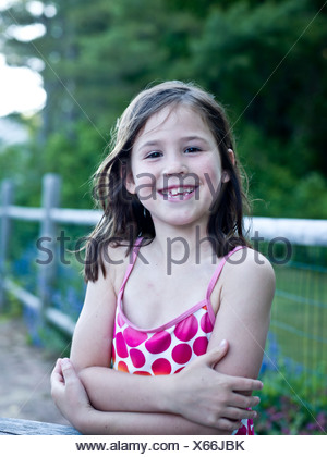 a happy girl in her bathing suit - Stock Photo