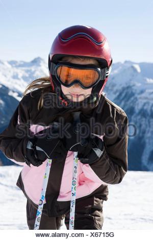 Portrait of young girl in ski kit - Stock Photo
