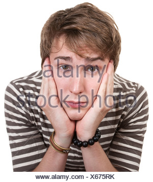 Bored young man with hands on face over white background - Stock Photo