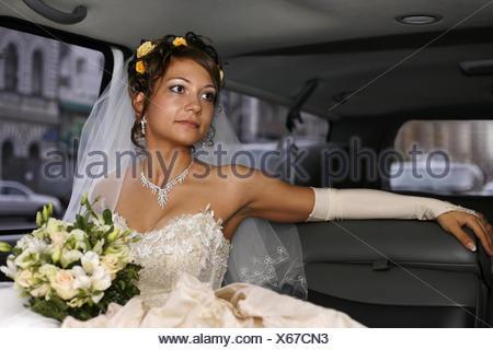 Bride in car - Stock Photo