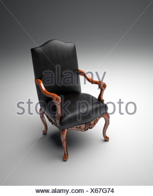 An empty black leather armchair - Stock Photo