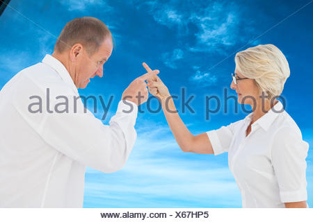 Composite image of angry older couple arguing with each other - Stock Photo