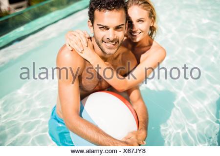 Happy couple with beach ball