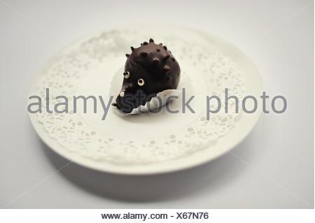 sweet cakes hedgehog food isolated on white - Stock Photo