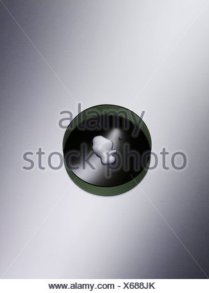 Cosmetic cream in bowl on gray background, close up - Stock Photo