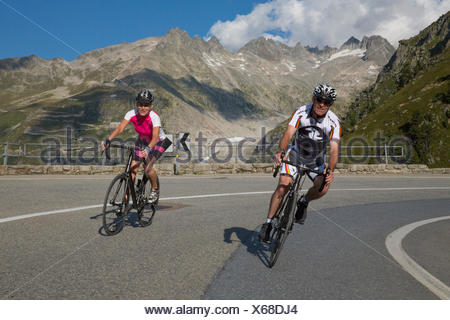 Gletsch VS, riding a bicycle, Grimsel Pass, canton, VS, Valais, glacier, ice, moraine, bicycle, bicycles, bike, riding a bicycle - Stock Photo