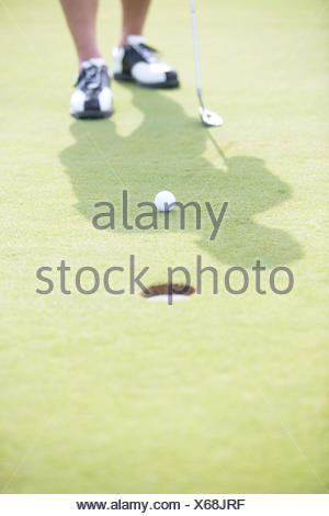 Low section of man playing golf - Stock Photo