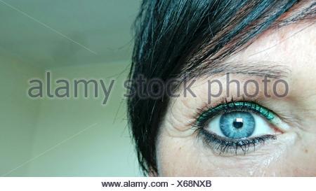 Close-Up Woman Eye Indoors - Stock Photo