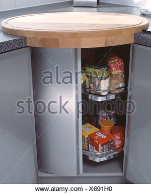 Close Up Of Pulses And Stock Cubes On Shelves In Modern Carousel Kitchen  Cupboard   Stock