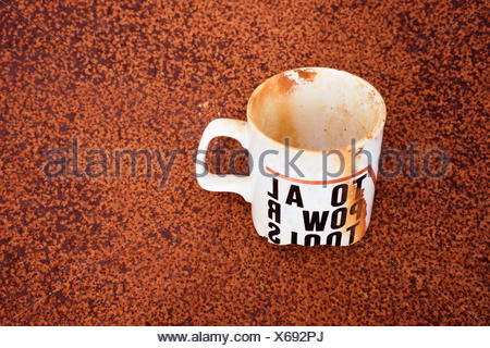 Stained Single White Cup Buried - Stock Photo
