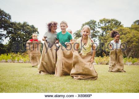 Children having a sack race - Stock Photo