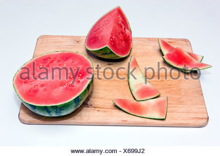 Slices of ripe watermelon on cutting board - Stock Photo