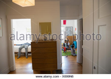 Family playing and resting in bedrooms - Stock Photo