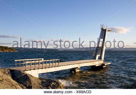 tower board sport sports norway outdoor wave platform dive high salt water sea - Stock Photo