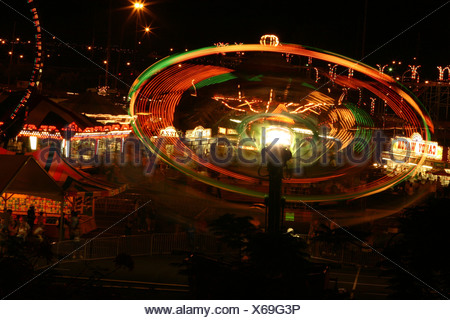 Long-exposure of carnival ride at the 50th State Fair on Oahu, Hawaii. - Stock Photo