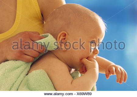 Nut, detail, baby, hold, dry up, curled woman, young, maternity, care, baby care, care, child, 6 months, smile, have of a bath, happy, bathed, dry, towel, softly, softly, carefully - Stock Photo