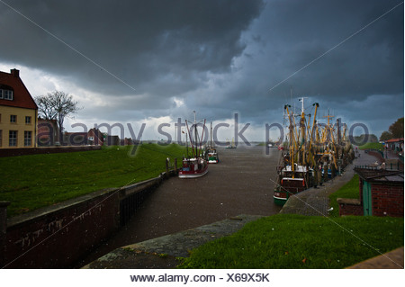 Harbour, cloudy sky, Greetsiel, East Frisia, Lower Saxony, Germany, Europe - Stock Photo